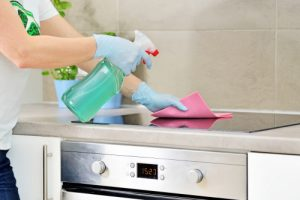 How do you deep clean kitchen cabinets